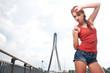Beautiful woman after fitness training on bridge