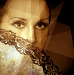 Art photo of beautiful brunette woman with fan.