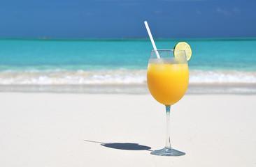 Orange juice on the beach. Exuma, Bahamas