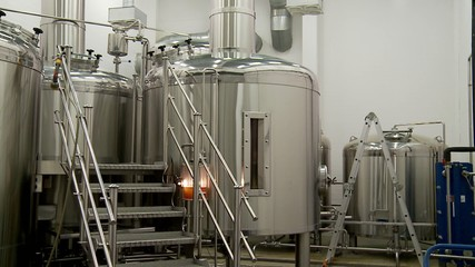 Large steel vats (Kettles) in the brewhouse of a brewery.