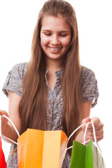 Teenager girl with shopping bags