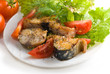 Mackerel with some fresh vegetables on a white plate,