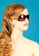 Beauty, fashion, glamor. Portrait of a beautiful redheaded styli