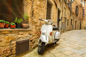 Old Vespa scooter on the street in Italy
