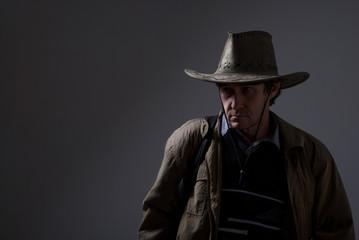 Portrait of a pensive man in a cowboy hat.