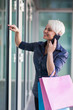 Attractive blonde woman with shopping bags