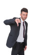Negative businessman gives thumbs down gesture - on white