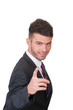 Smart dynamic young businessman pointing - on white