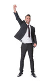 Successful businessman punches the air with joy
