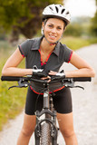 Portrait of woman with mountain bike