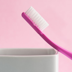 Toothbrush over pink