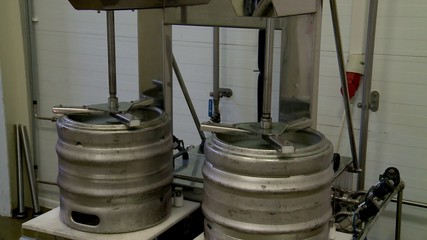 Flushing beer kegs at a brewery.