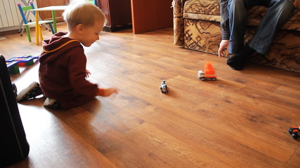 kid playing with toy cars