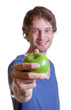 Young man offering an apple