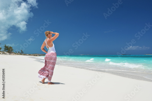Girl on the desrt beach. Exuma, Bahamas