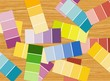 Color pattern strips scattered at the wood table