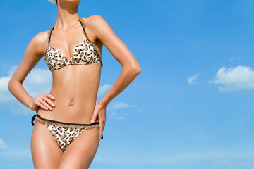 female slim body in bikini