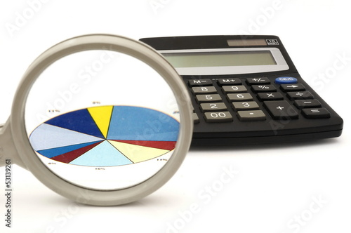 concept of analyzing in office with magnifier,calculator,graph