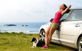 Fototapety Happy woman and dog travel