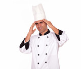 Tired male cook standing with headache