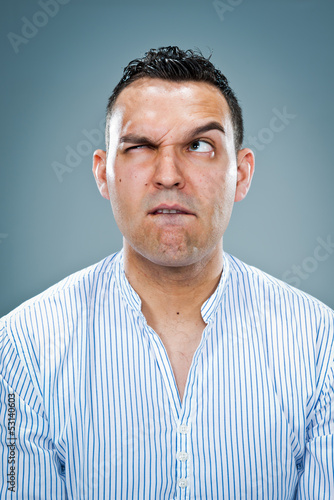 Mid Adult Man with Confused Expression