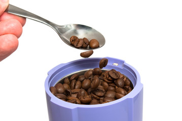 coffee beans in coffee grinder