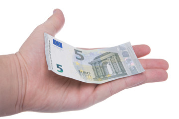 hand is holding a new 5 euro banknote