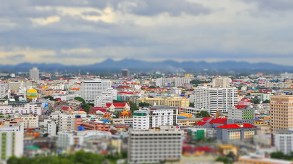 Tilt-shift style of Town with cloud sky - Pattaya town , Thailan