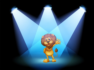 A stage with a lion waving in the middle