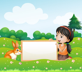 A girl holding an empty blank board with a rabbit