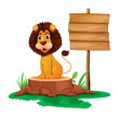 A lion sitting on a stump beside an empty wooden signboard