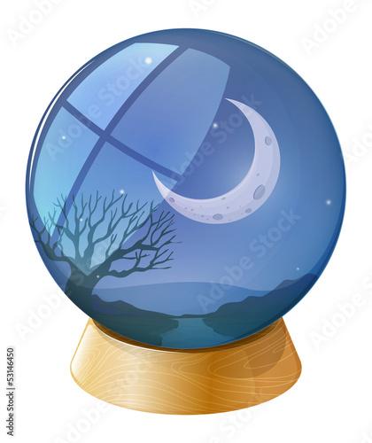 A crystal ball with a moon