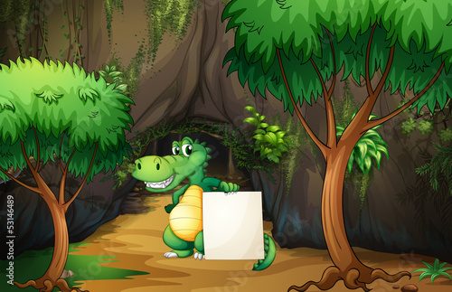 Wall mural A crocodile holding an empty paper outside the cave