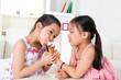 Asian girls eating ice cream