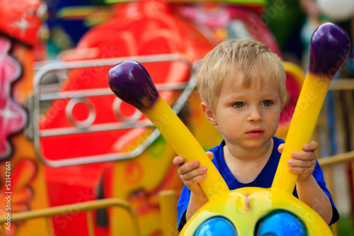 little boy in amusement park