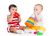 babies girls playing toy together