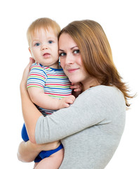 mother embracing baby boy isolated on white