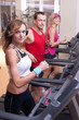 Group of people running on treadmill in gym