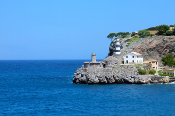 Lighthouse on the rock in Port de Soller, Mallorca
