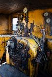 Yellow engine room on the steam locomotive