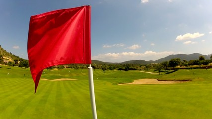 Flag on a lush green golf course