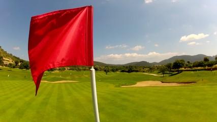 Flag on a lush green golf course