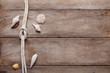 Weathered wooden table background with rope reef knot and shells