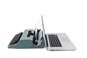 contemporary laptop vs old typewriter