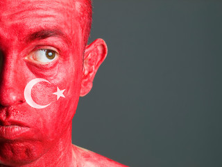 Face man Turkish flag and distrustful expression