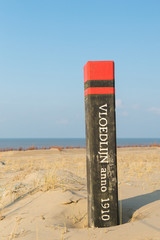 High tide pole at Texel