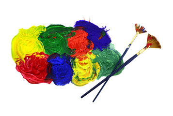 Two brushes and colorful paint mix isolated