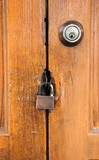 master key on wood door and  key knob