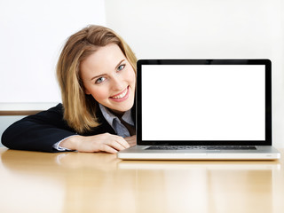 Business woman presenting her laptop with copyspace