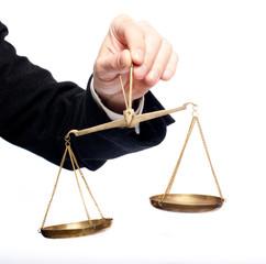 hand holding a balance